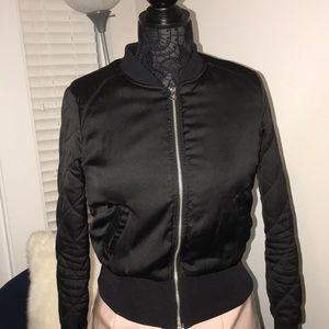 Women's bomber with quilted sleeve detail.